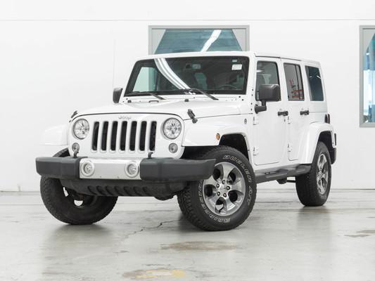 White Jeep Wrangler JK Unlimited Sahara 4WD