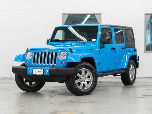 Blue Jeep Wrangler JK Unlimited Sahara 4WD