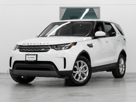 White Land Rover Discovery SE