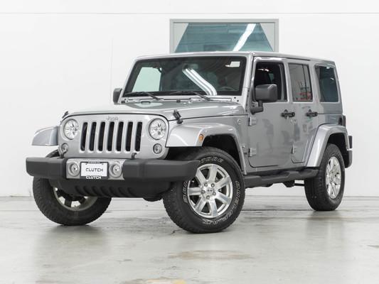 Silver Jeep Wrangler JK Unlimited Sahara 4WD