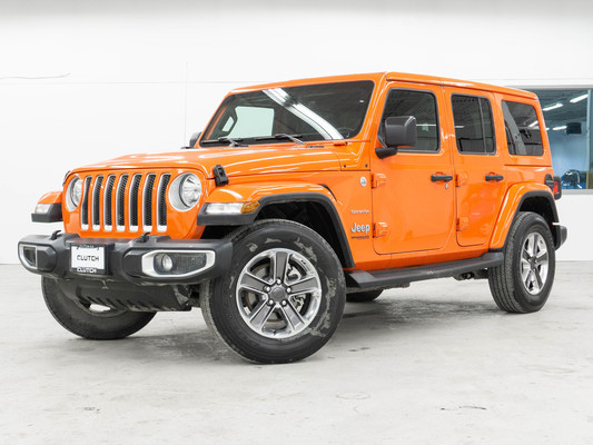 Orange Jeep Wrangler Unlimited Sahara 4WD