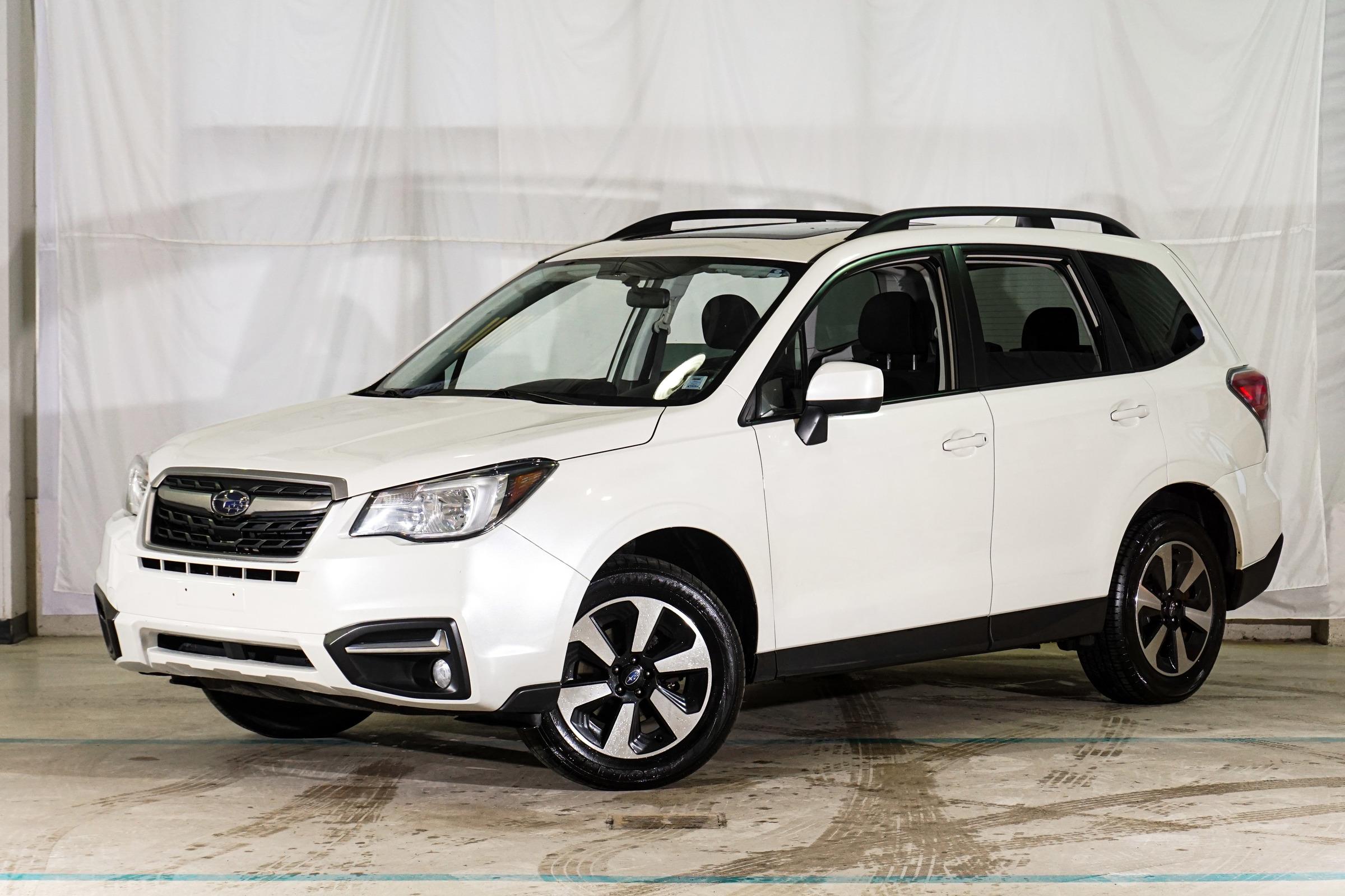 White Subaru Forester 2.5i Touring