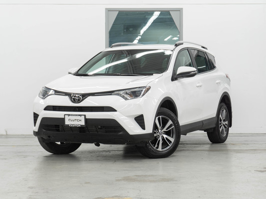 White Toyota RAV4 LE