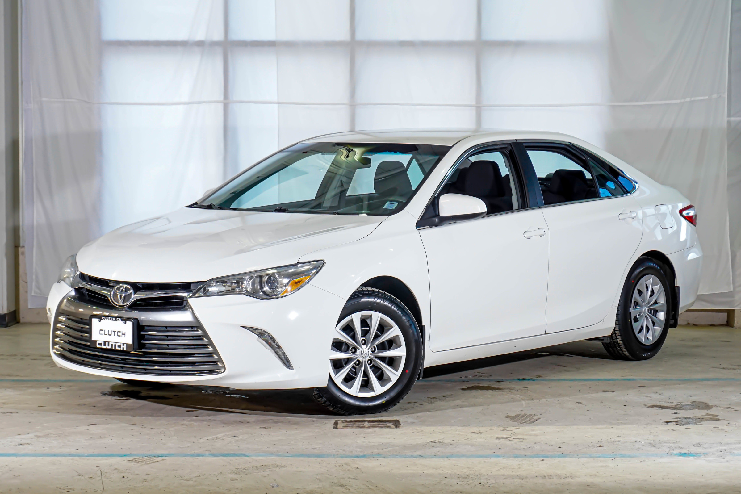 White Toyota Camry LE