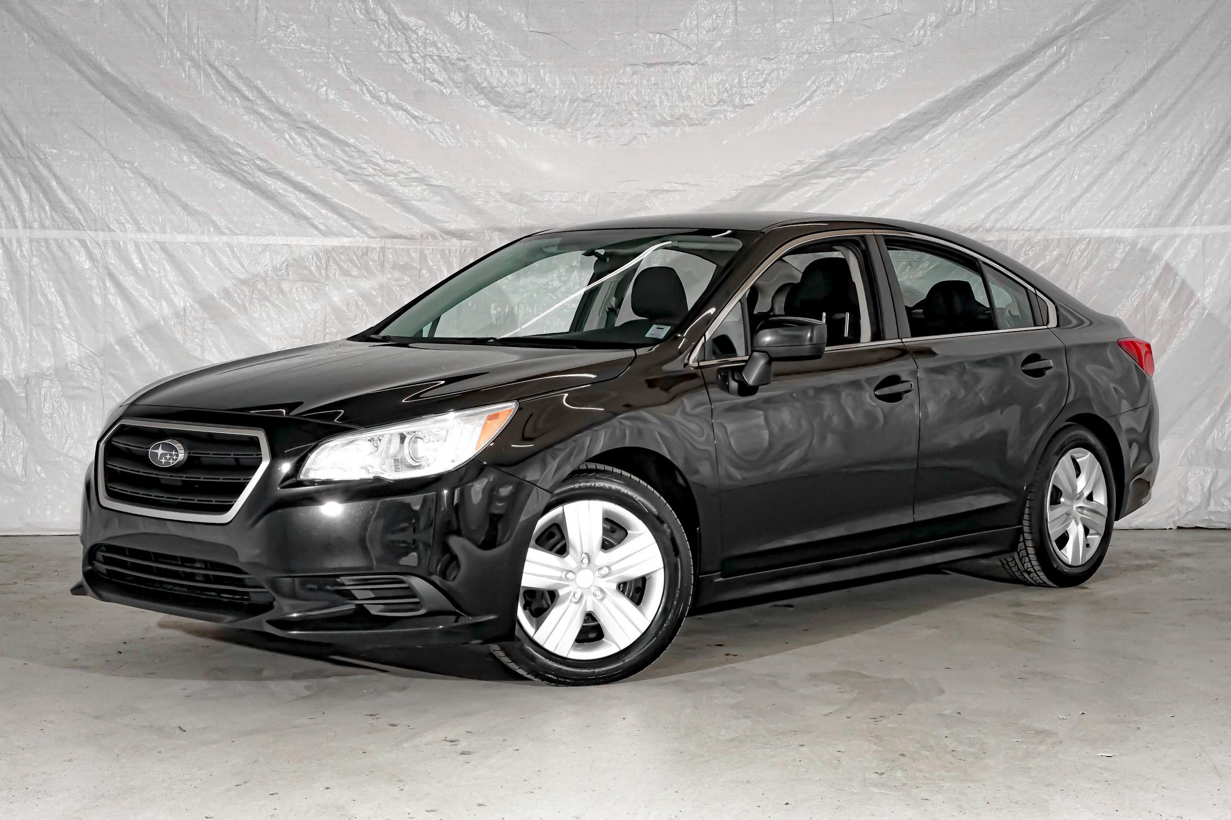 Black Subaru Legacy 2.5i