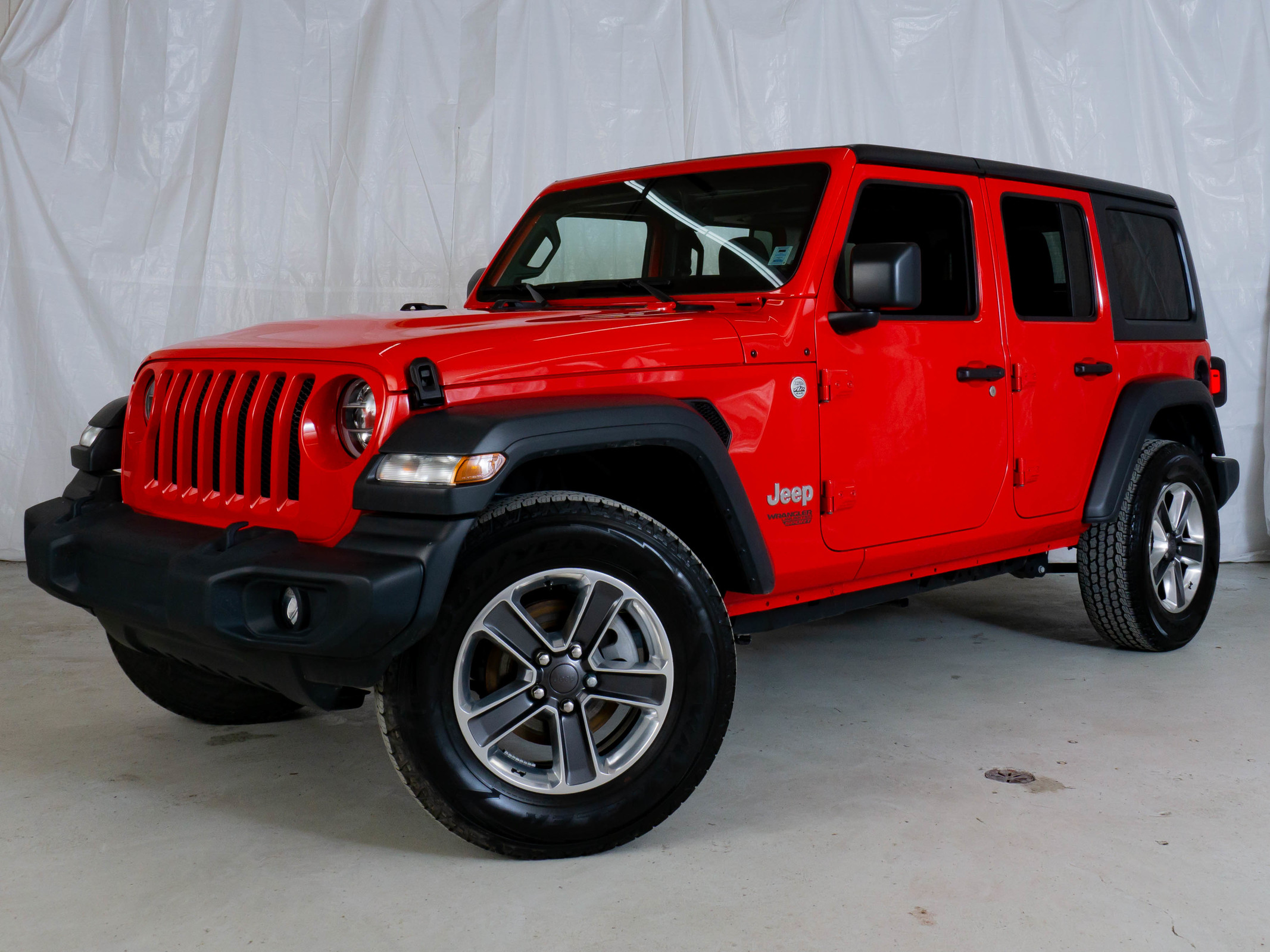 Red Jeep Wrangler Unlimited Sport