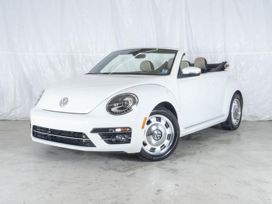 White Volkswagen Beetle Convertible Coast