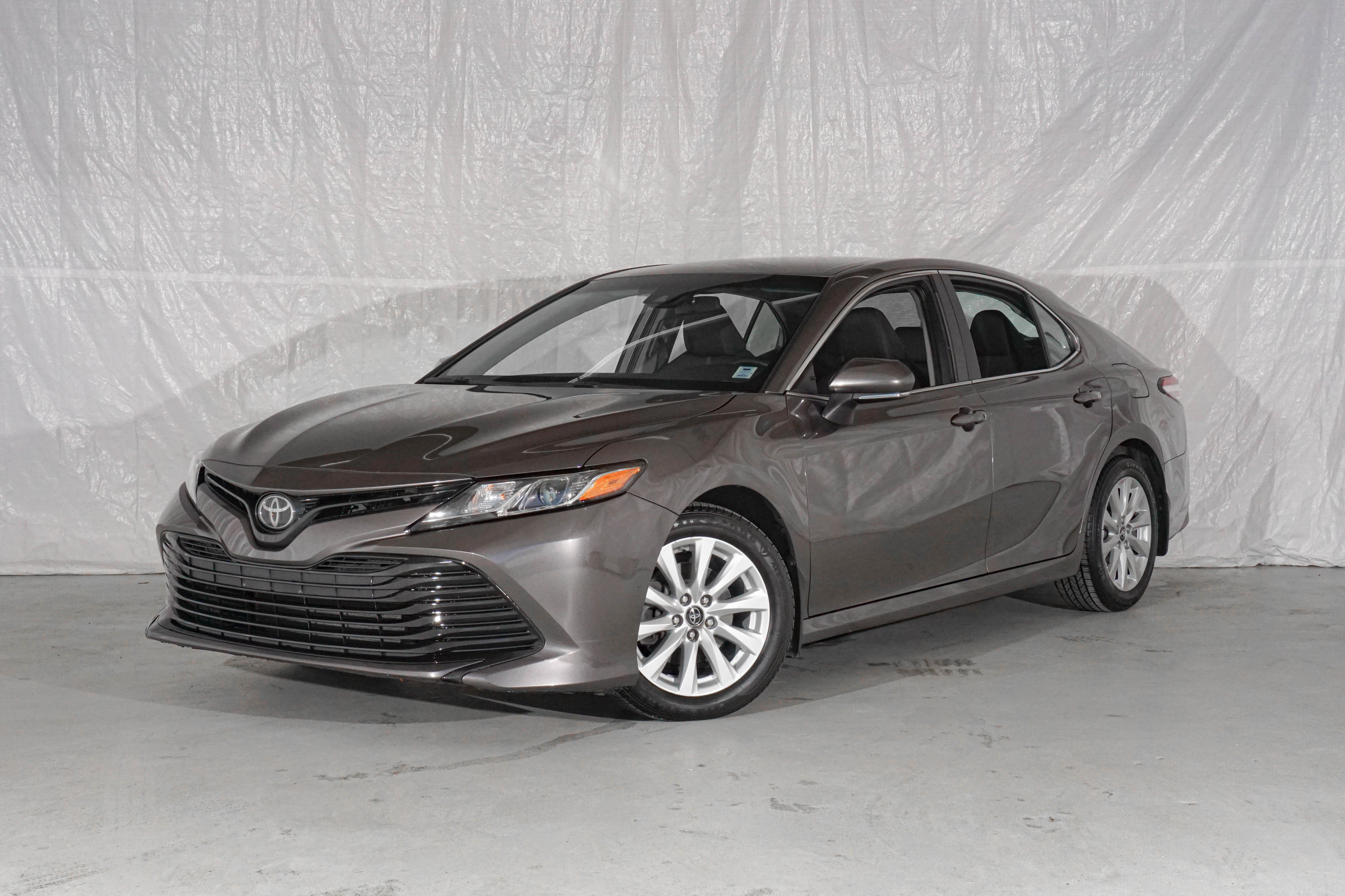 Grey Toyota Camry LE