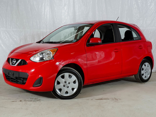 Red Nissan Micra SV