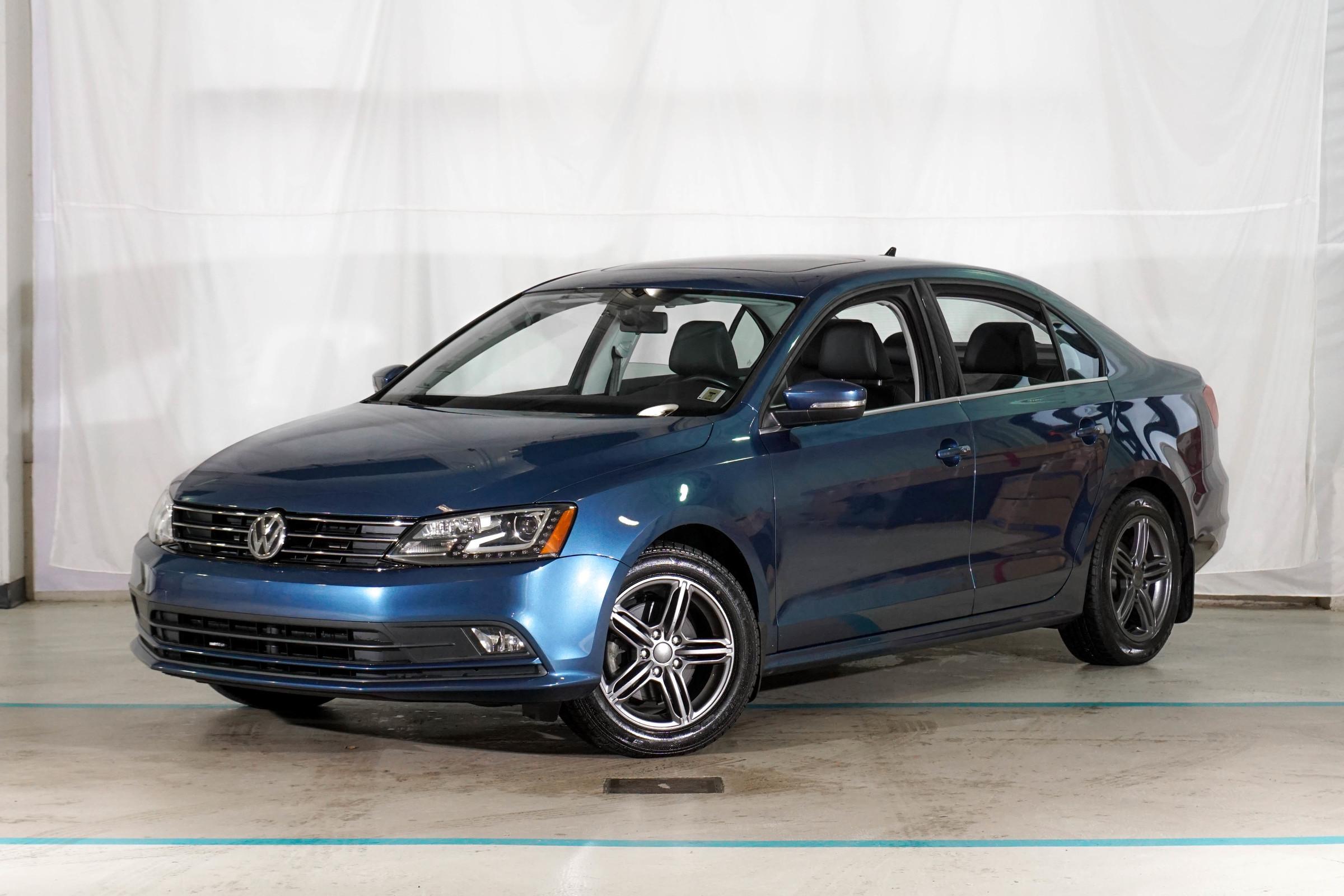 Blue Volkswagen Jetta Highline